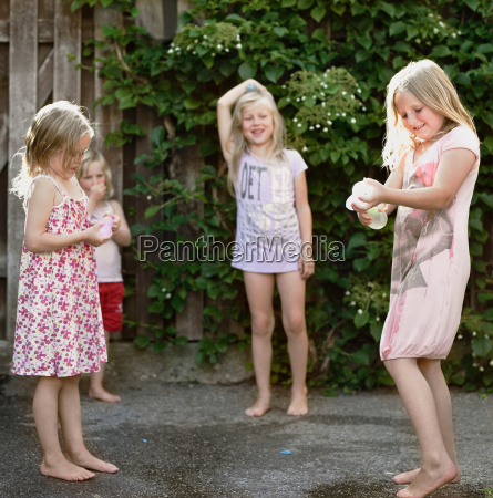 girls playing together on concrete