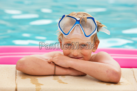 boy wearing mask in swimming pool