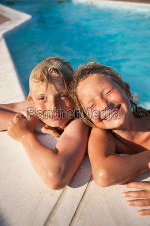 smiling children in swimming pool