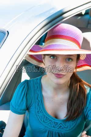 woman in colorful hat sitting in
