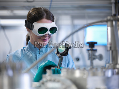 female scientist holding a mounted laser