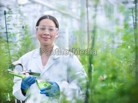 portrait of scientist in nursery of