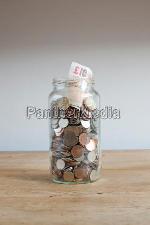 savings jar on desk