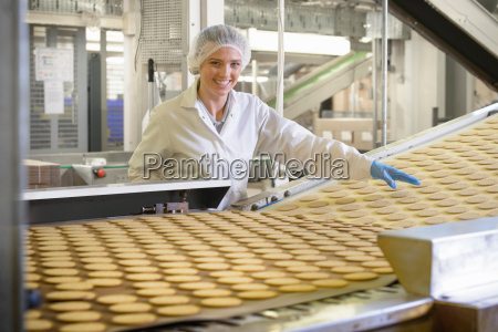 portrait of biscuit factory worker inspecting