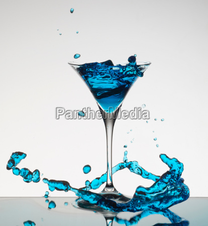cocktail splashing around martini glass
