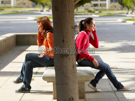 two teenagers on their mobile phone
