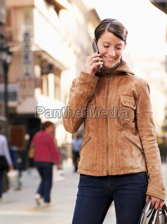 young woman standing in street on