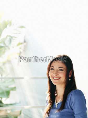 woman standing by window smiling
