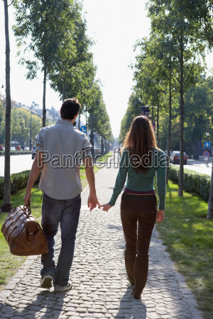 couple walking together with a large