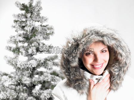 woman next to a fir tree