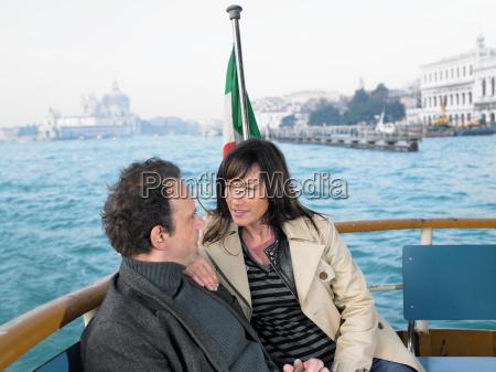 couple on vaporetto boat venice italy