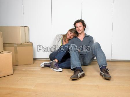 couple sitting on floor smiling