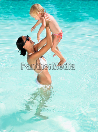 woman and young boy playing in