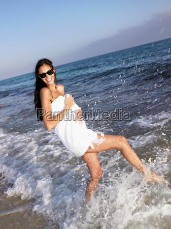 woman splashing in water wearing a