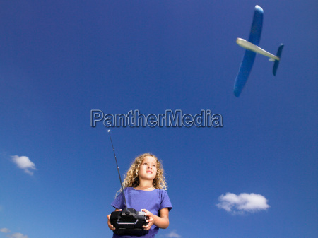 young girl with remote control