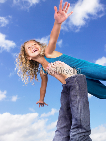 young girl swirling feet in the
