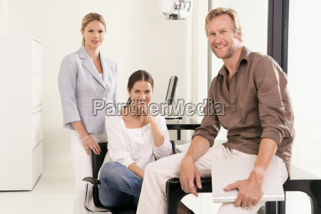 man and two women in office