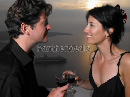 couple toasting glasses sea view