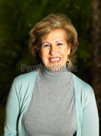 senior woman in garden smiling