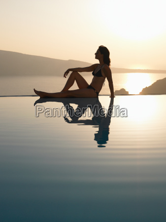 woman sitting on the edge of