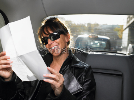 woman reading a letter in a