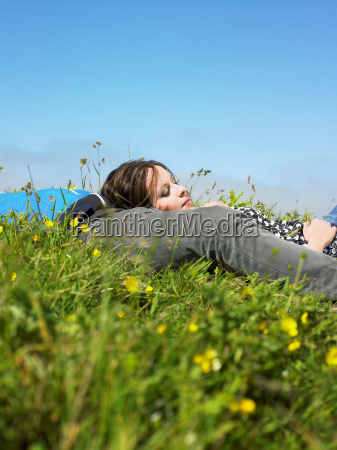 you couple lying in the grass