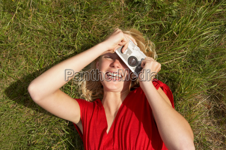 young woman with fake toy camera