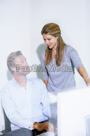 man and woman in office on