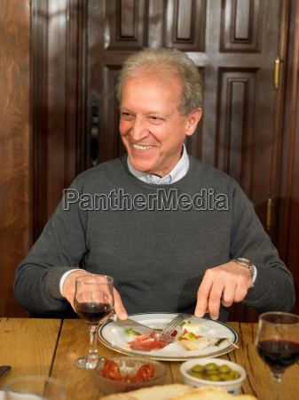 senior adult man eating lunch smiling