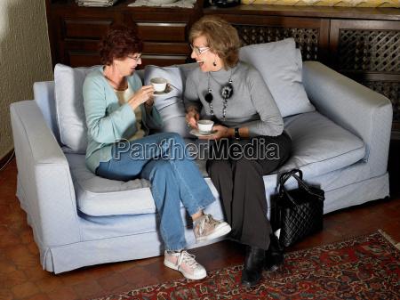 two senior adult women sitting on