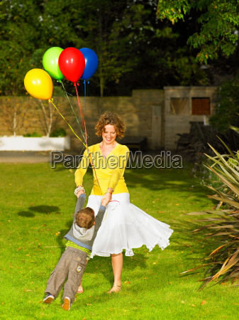 mother and son playing in garden
