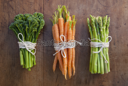bunches of carrots broccoli and asparagus