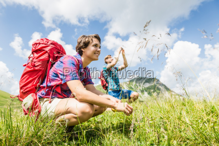 young couple hiking tyrol austria