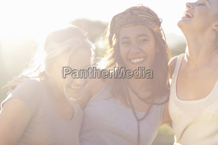 three young female friends laughing