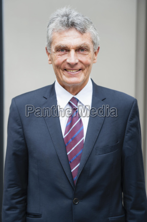 portrait of senior businessman in city