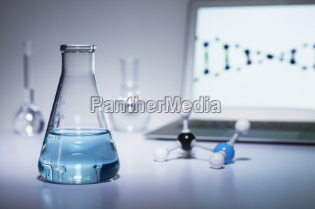 chemistry research erlenmeyer flask containing colored