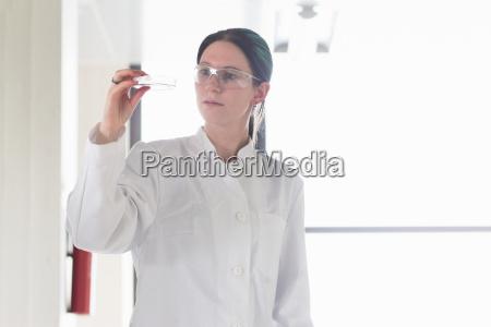 portrait of female scientist examining test