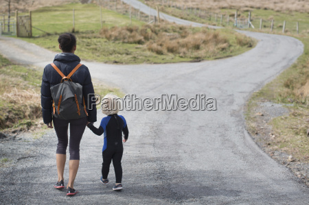 mother and son walking on country