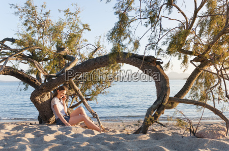 mid adult woman on beach chatting