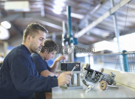 engineer working on production line in