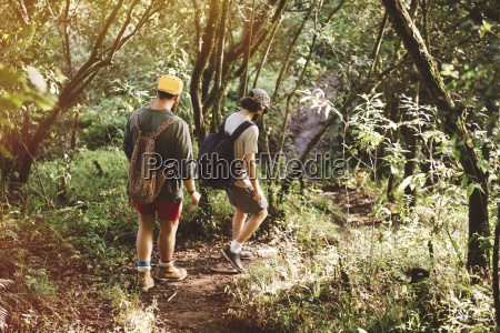 two young male friends hiking in