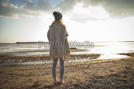 young woman gazing on bournemouth beach