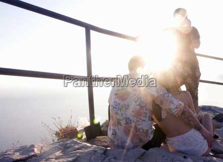 three young adult friends on sunlit