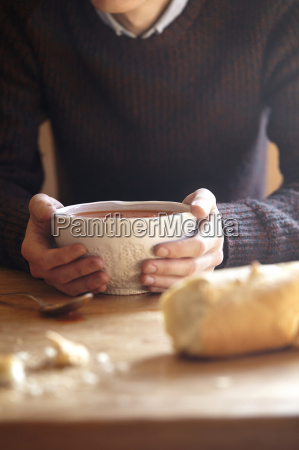 young man at kitchen table with