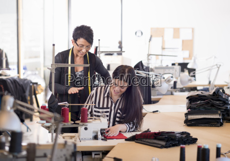 two seamstresses at sewing machine in
