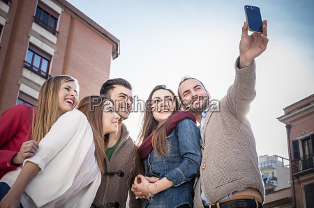 mid adult man taking smartphone selfie