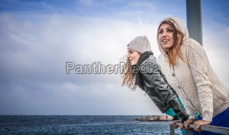 two young women friends looking at