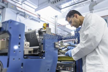 scientist manufacturing lithium ion batteries in