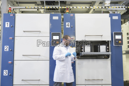 scientist with lithium ion pouch cell