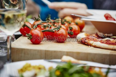 fresh vine tomatoes on chopping board